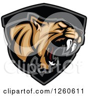 Clipart Of A Roaring Aggressive Cougar Mascot Over A Black Shield Royalty Free Vector Illustration