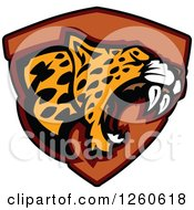 Clipart Of A Roaring Aggressive Leopard Mascot Over A Black Shield Royalty Free Vector Illustration
