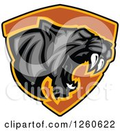 Clipart Of A Roaring Aggressive Black Panther Mascot Over A Black Shield Royalty Free Vector Illustration by Chromaco