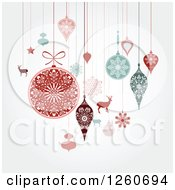 Clipart Of Retro Suspended Christmas Baubles And Items On Shading Royalty Free Vector Illustration by OnFocusMedia