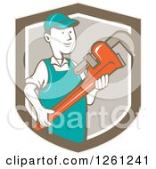 Clipart Of A Retro Cartoon Plumber Holding A Monkey Wrench In A Brown Shield Royalty Free Vector Illustration