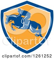 Clipart Of A Retro Male Jockey On A Leaping Horse In A Blue White And Yellow Shield Royalty Free Vector Illustration