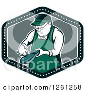 Clipart Of A Retro Cartoon Shoemaker Working In A Shield Royalty Free Vector Illustration by patrimonio