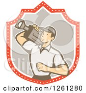 Clipart Of A Retro Cartoon Cameraman Filming In A Shield Royalty Free Vector Illustration