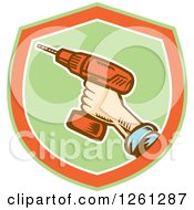 Poster, Art Print Of Retro Woodcut Hand Holding A Cordless Drill In A Green Orange And White Shield