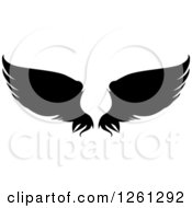 Clipart Of Black Silhouetted Feathered Wings Royalty Free Vector Illustration by Chromaco