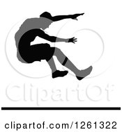 Black Silhouetted Male Athlete Long Jumper