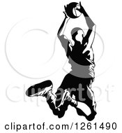 Clipart Of A Black And White Basketball Player In Action Royalty Free Vector Illustration