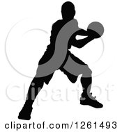 Black Silhouetted Basketball Player In Action