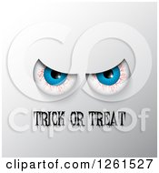 Clipart Of Bloodshot Eyes Over Trick Or Treat Text On Gray Royalty Free Vector Illustration