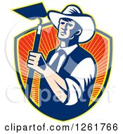 Clipart Of A Retro Woodcut Cowboy Farmer Holding A Hoe Over A Shield Of Rays Royalty Free Vector Illustration