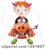 Cute Red Haired Boy Trick Or Treating As A Devil On Halloween
