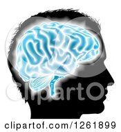 Clipart Of A Silhouetted Mans Head With A Glowing Blue Brain Royalty Free Vector Illustration