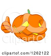 Clipart Of A Jackolantern Pumpkin Holding A Thumb Up Royalty Free Illustration by Julos