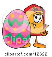 Clipart Picture Of A Price Tag Mascot Cartoon Character Standing Beside An Easter Egg
