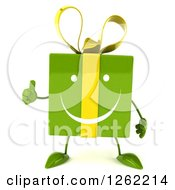 Clipart Of A 3d Happy Green Gift Chacter Holding A Thumb Up Royalty Free Illustration