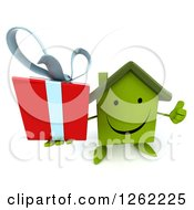 Clipart Of A 3d Happy Green House Character Holding A Gift And A Thumb Up Royalty Free Illustration