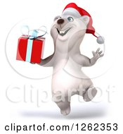 Clipart Of A 3d Christmas Polar Bear Jumping With A Gift Royalty Free Illustration
