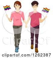 Happy Gay Couple Waving Flags In A Gay Pride March