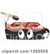 Bento Box Holding Up Sushi