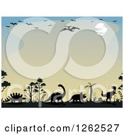 Clipart Of A Sunset Background Bordered In Birds And Dinosaurs Royalty Free Vector Illustration