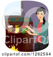 Happy Woman Hanging Christmas Stockings On A Hearth