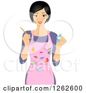 Clipart Of A Happy Woman Artist Holding Paint And Wearing A Splattered Apron Royalty Free Vector Illustration