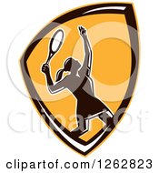 Clipart Of A Retro Silhouetted Female Tennis Player Serving Inside An Orange Black And White Shield Royalty Free Vector Illustration