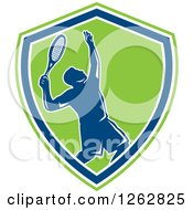 Clipart Of A Retro Silhouetted Male Tennis Player Serving Inside A Blue White And Green Shield Royalty Free Vector Illustration