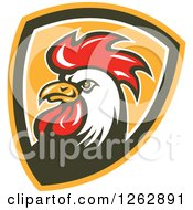 Clipart Of A Retro Cartoon Rooster In A Shield Royalty Free Vector Illustration