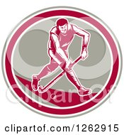 Clipart Of A Retro Woodcut Male Field Hokey Player In A Taupe White And Pink Oval Royalty Free Vector Illustration