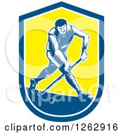 Clipart Of A Retro Woodcut Male Field Hokey Player In A Blue White And Yellow Shield Royalty Free Vector Illustration