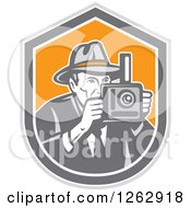 Clipart Of A Retro Male Photographer In A Fedora Hat In A Gray White And Orange Shield Royalty Free Vector Illustration