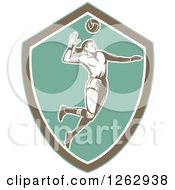 Clipart Of A Retro Woodcut Female Volleyball Player Spiking In A Turquoise Brown And White Shield Royalty Free Vector Illustration by patrimonio