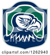 Clipart Of A Tough Falcon Head In A Green Blue And White Shield Royalty Free Vector Illustration by patrimonio