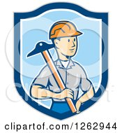 Clipart Of A Cartoon Male Engineer Holding A T Square In A Blue Shield Royalty Free Vector Illustration