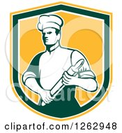 Clipart Of A Retro Male Chef Or Baker Holding A Rolling Pin In A Yellow White And Green Shield Royalty Free Vector Illustration