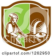 Clipart Of A Retro Woodcut Medieval Baker Putting Bread In A Stone Oven In A Brown White And Green Shield Royalty Free Vector Illustration