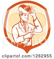 Clipart Of A Retro Male Scientist Welding In An Orange And White Shield Royalty Free Vector Illustration by patrimonio