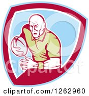 Clipart Of A Retro Male Rugby Player Running In A Blue Red And White Shield Royalty Free Vector Illustration