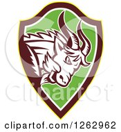 Clipart Of A Retro Aggressive Mountain Goat Ram In A Yellow Brown White And Green Shield Royalty Free Vector Illustration