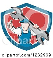 Clipart Of A Cartoon Male Mechanic Holding A Thumb Up And Carrying A Giant Wrench In A Blue White And Red Shield Royalty Free Vector Illustration