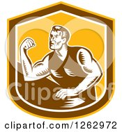 Clipart Of A Retro Woodcut Male Arm Wrestling Champion In A Yellow Brown And White Shield Royalty Free Vector Illustration