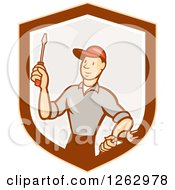 Clipart Of A Cartoon Male Electrician Holding A Scredriver And Plug In A Shield Royalty Free Vector Illustration by patrimonio