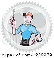 Clipart Of A Cartoon Male Electrician Holding A Scredriver And Plug In A Gray Burst Circle Royalty Free Vector Illustration by patrimonio