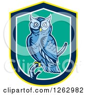 Clipart Of A Retro Woodcut Blue Great Horned Owl In A Yellow Blue White And Turquoise Shield Royalty Free Vector Illustration by patrimonio