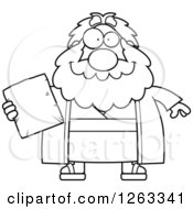 Clipart Of A Black And White Cartoon Happy Chubby Moses Holding A Tablet Royalty Free Vector Illustration by Cory Thoman