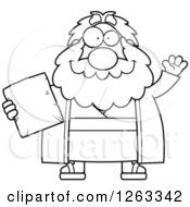 Clipart Of A Black And White Cartoon Friendly Waving Chubby Moses Holding A Tablet Royalty Free Vector Illustration by Cory Thoman