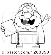 Clipart Of A Black And White Cartoon Smart Chubby Moses Holding A Tablet With An Idea Royalty Free Vector Illustration by Cory Thoman