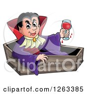 Dracula Vampire Sitting In A Coffin With A Glass Of Blood